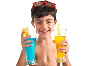 Child holding fruit drinks